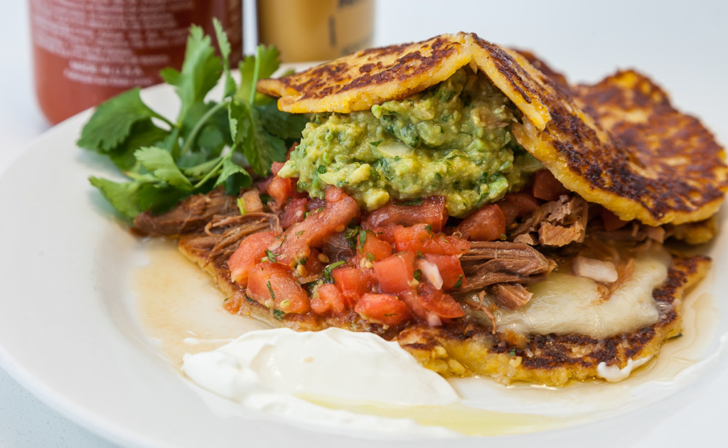 Tamale Cakes with Cumin Crusted Pork